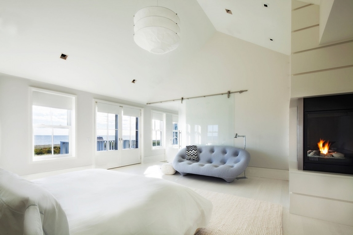 Bedroom in Contemporary style home on the beach