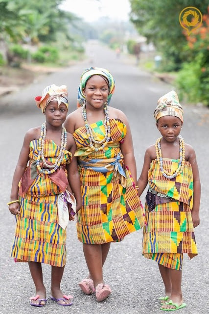 Three beautiful girls in their awesome Kente cloths Ghana