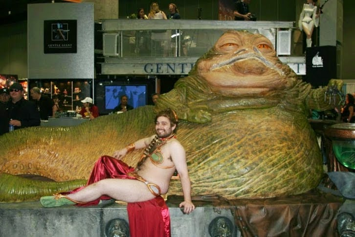 Man doing princess leia slave costume