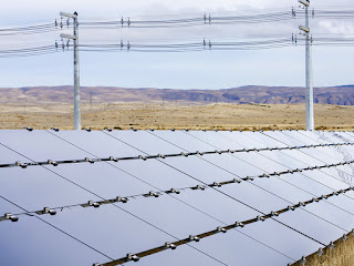 Solar photovoltaic panels in the desert near Phoenix (Photo Credit: Arizona Public Service) Click to Enlarge.