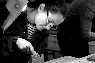 Image of a woman chiselling a dovetail joint.