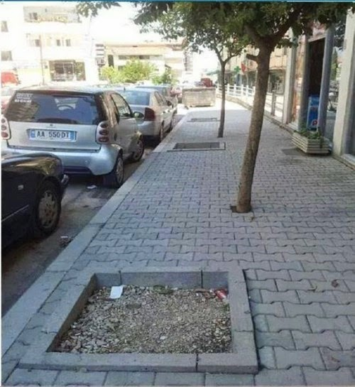 badly designed middle eastern pavement holes for trees funny fail