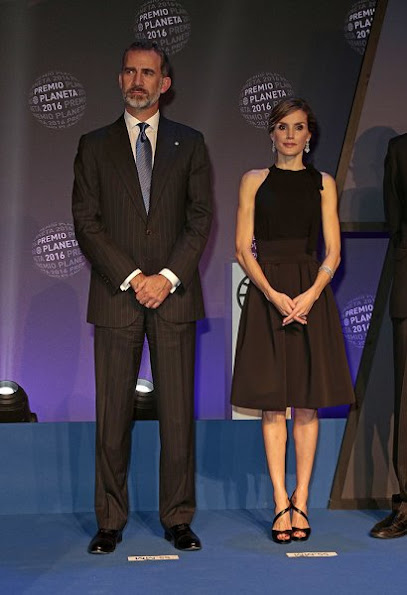 Queen Letizia wore Signe Bøgelund Jensen Two Fold Skirt, Tod's. Black Satin Clutch, Magrit Sandals