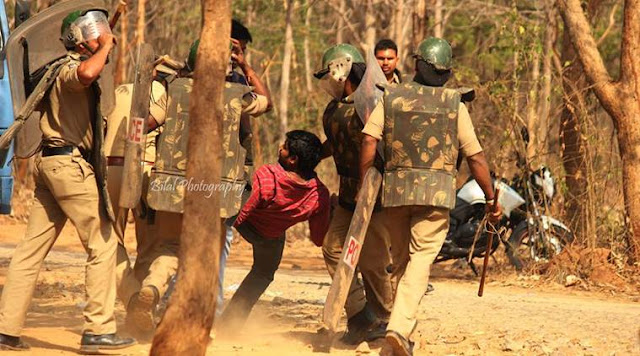 Police beating up student in University of Hyderabad