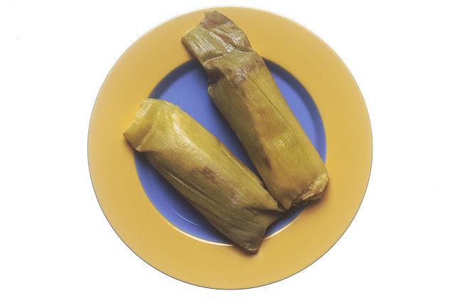 Two Tamales Still in Corn Husks