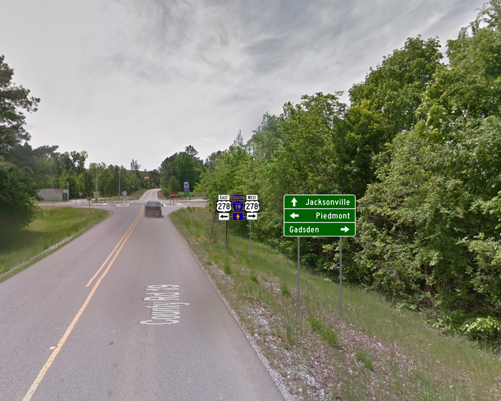 the actual image from google maps above shows a tornado damaged guide sign that was already decades old not being maintained a the junction of us 278