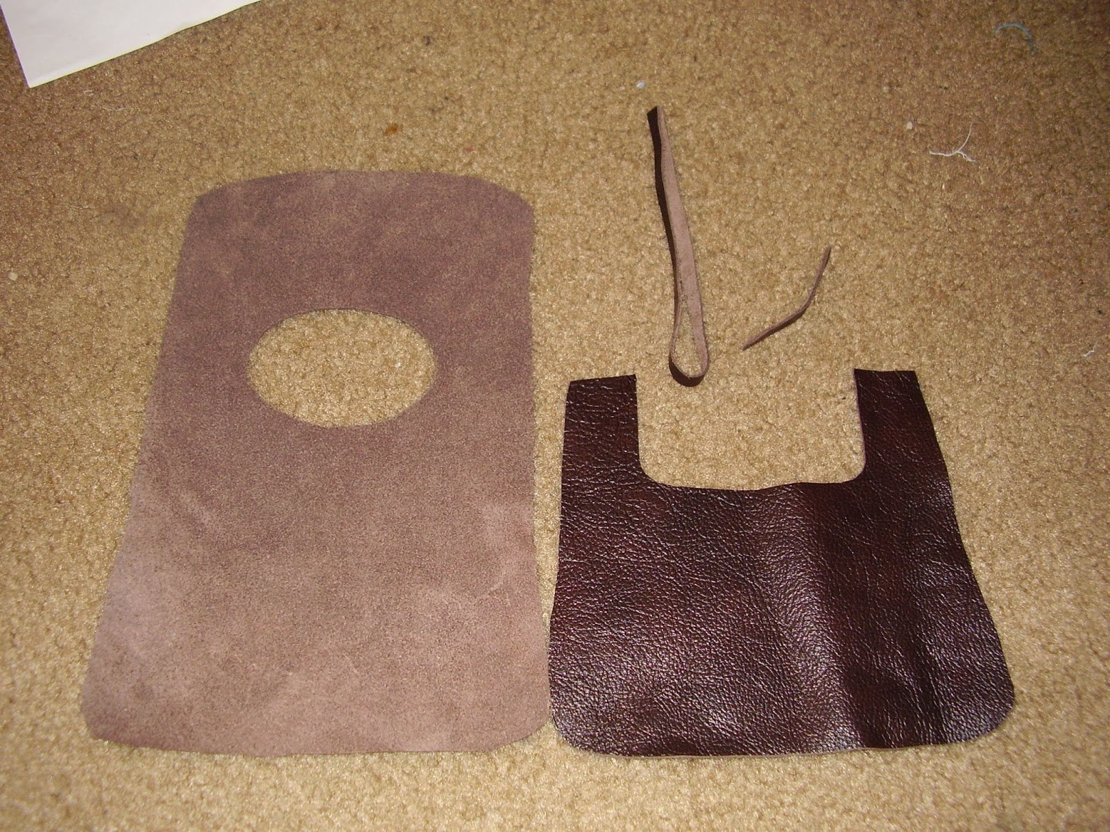 Pieces cut out: bag back/lid, front, and ties.