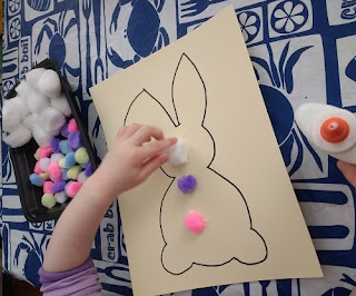 gluing pom poms onto the rabbit in this activity
