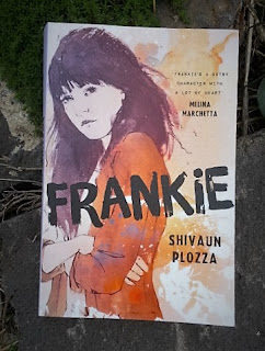 "A photograph of the novel Frankie with the following text: ""Frankie, Shivaun Plozza, Frankie's a gutsy character with a lot of heart, Melina Marcheta."""