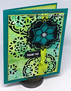 Linda Vich Creates: Watercoloring With The Eastern Palace Suite. A watercolored panel is die cut using the Eastern Medallions Thinlits and then embellished with more die cuts for a stunning result.