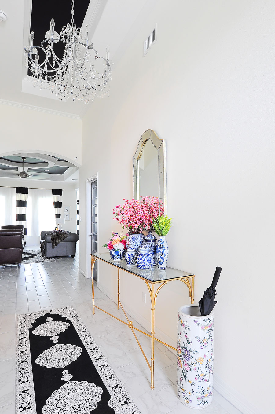Why I chose to have all white walls in my new home. (I love all the contrast and glam decor in this foyer space with chinoiserie vibes!)