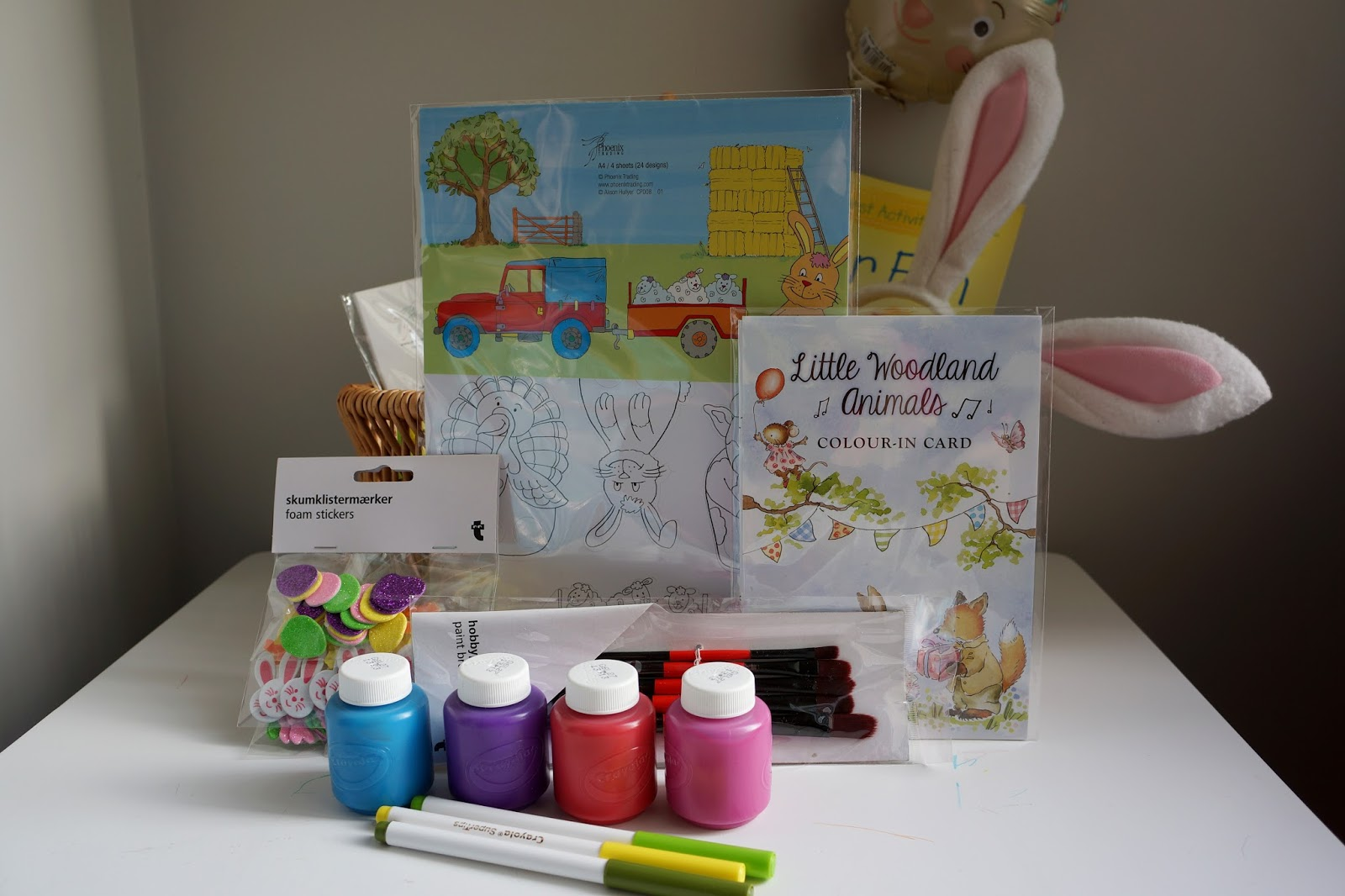 paints, felt tip pens, colouring pads and paint brushes and foam stickers