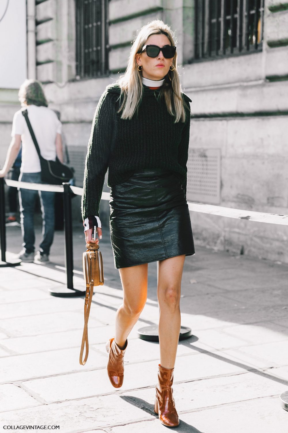 Camille Charrière Fall Outfit Inspiration – Chunky Sweater, Leather Mini Skirt, and Booties