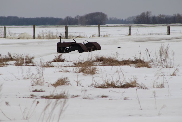 An old tractor buried in the snow