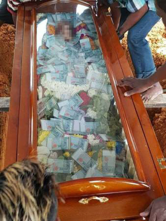 Photos: Man buries his father with US$7,630 in cash filled inside glass-topped coffin