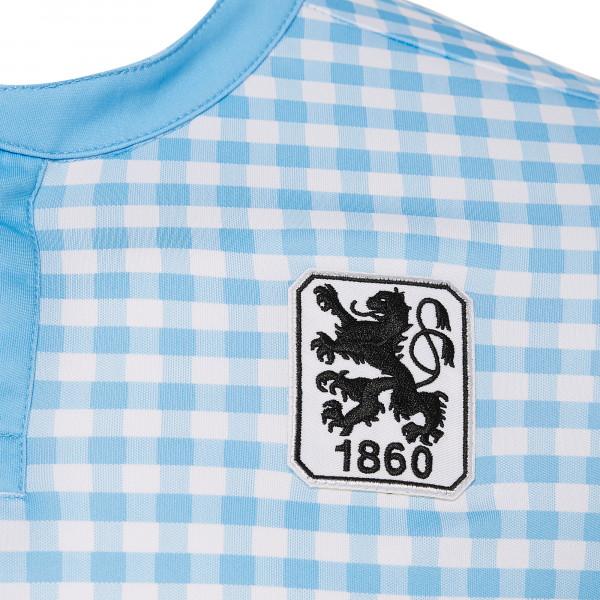 La maglia da gara Oktoberfest del Monaco 1860 si tinge di azzurro. Sulle  maniche 3b34a08534d6c