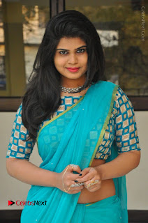 Telugu Actress Alekhya Stills in Green Saree at Swachh Hyderabad Cricket Press Meet  0013.JPG
