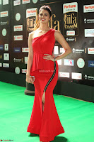 Meenakshi Dixit in Red One Shoulder Red Zipped up gown at IIFA Utsavam Award 85.JPG