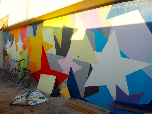 Street art of colourful star patterns in the Ji-dong mural village in Suwon, South Korea