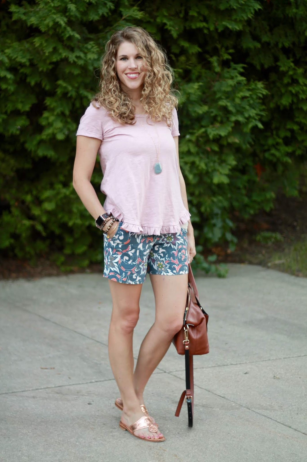 pink ruffle hem top, LOFT floral shorts, cognac crossbody bag, rose gold Jack Rogers sandals
