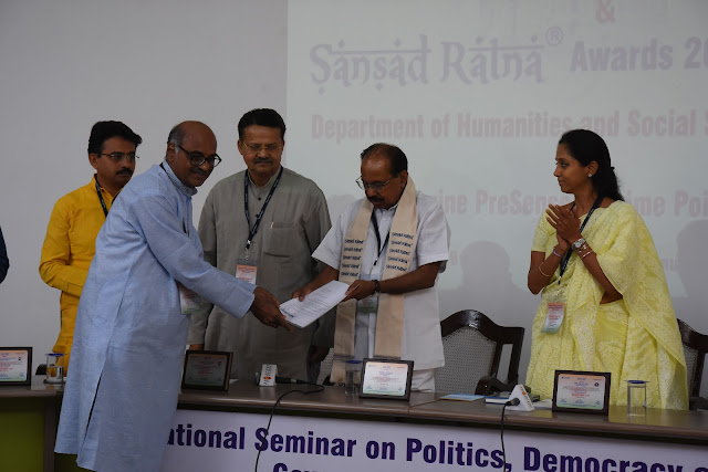 Prime Point Srinivasan, Publisher & Mg. Editor of PreSense and Convenor of Education Loan Task Force presents a petition to Dr Veerappa Moily.  Shri Rajeev Shankarrao Satav, Shri Bhartruhari Mahtab and Smt. Supriya Sule, Award winning Parliamentarians look on.
