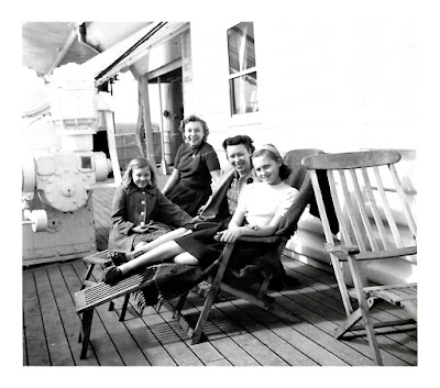 Lena Vasilev, Lana Thomson, Natalie Vasilev, and Tanya Sarsfield on board the SS Pacific Transport in 1953
