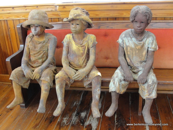 child sculptures by Woodrow Nash, inside church at Whitney Plantation in Wallace, Louisiana