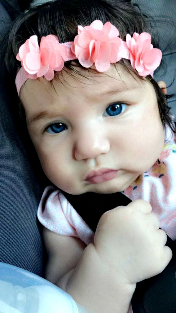 blue eyed baby with a pink headband