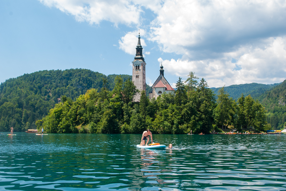 Paddle boarding on lake bled with bled island in the background