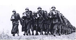 Polish troops (just before WW2) note French gas mask canisters