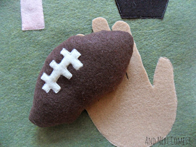 Close up of football for letter F quiet book page from And Next Comes L