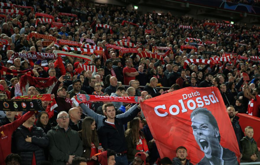 Fans-at-Anfield-with-banners-flags-and-scarfs
