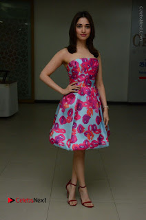 Actress Tamanna Latest Images in Floral Short Dress at Okkadochadu Movie Promotions  0144.JPG
