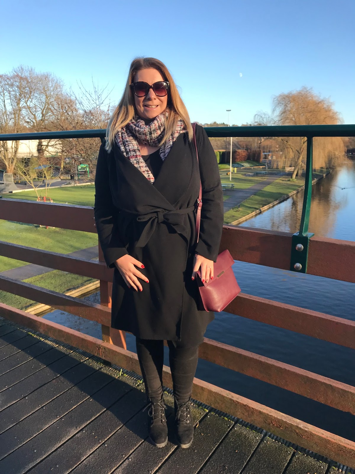 Basking in the winter sunshine wearing a classic black trench coat
