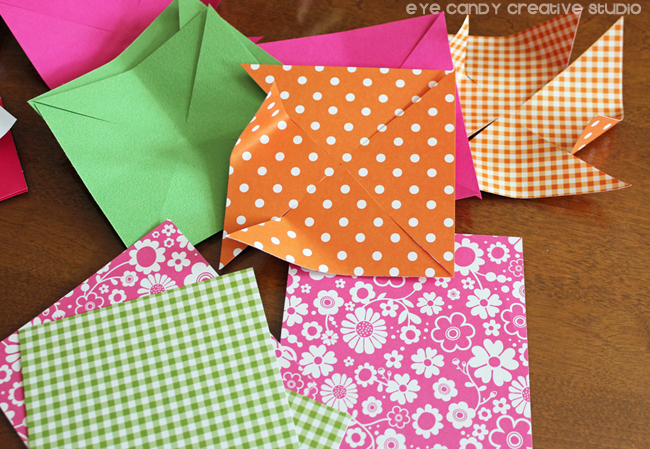 scrapbook paper to make pinwheel for summer pinwheel wreath, folding paper