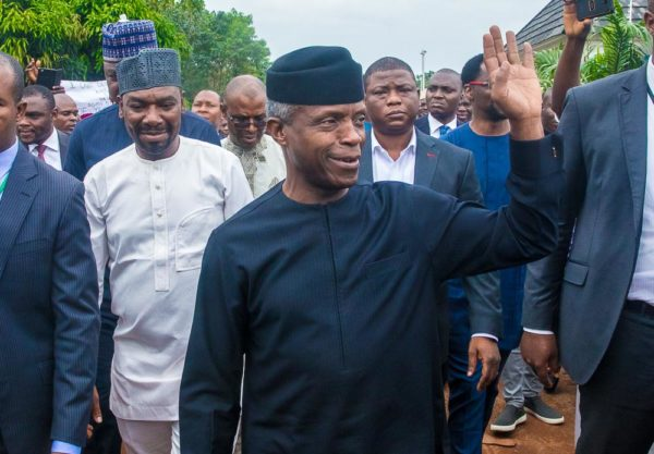 Osinbajo acknowledges cheers at the Radio Station in Abuja