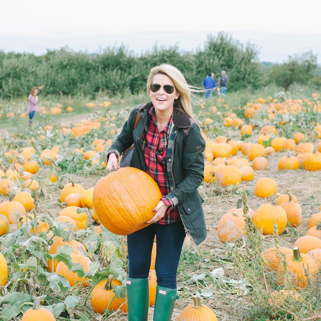 preppy outfit barbour jacket and hunter boots at a pumpkin patch