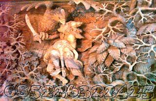 detail ukiran sinta di culik raksasa dibantu burung jati jepara