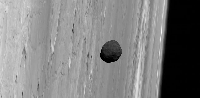 Phobos, the larger of Mars' two tiny satellites, is the darkest moon in the solar system. This dark aspect inspired the hypothesis that the close-orbiting moon may be a captured asteroid, but its orbital dynamics seemed to disagree. A new study suggests Phobos' composition may be more like the volcanic crust of the Red Planet than it appears, consistent with an origin for the moon in an ancient, violent impact on Mars. Credit: G. Neukum (FU Berlin) et al./ Mars Express/ DLR/ ESA; Acknowledgement: Peter Masek