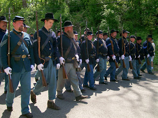 Reenactor soldiers marching in 150th Anniversary Lincoln Funeral Procession.