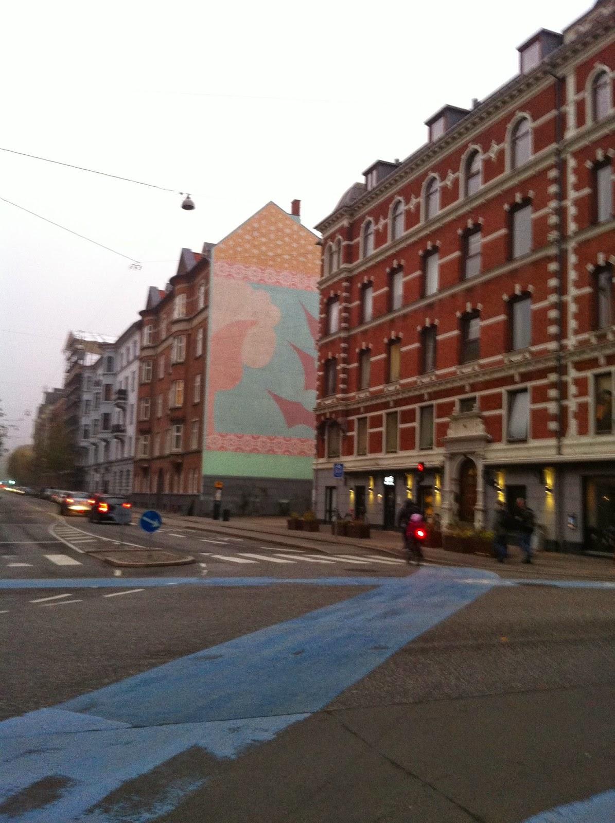 a pastel colored mural in copenhagen