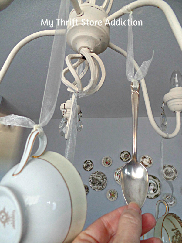 DIY Whimsical Teacup Chandelier mythriftstoreaddiction.blogspot.com Create a one of a kind chandelier with thrift store teacups and vintage spoons!