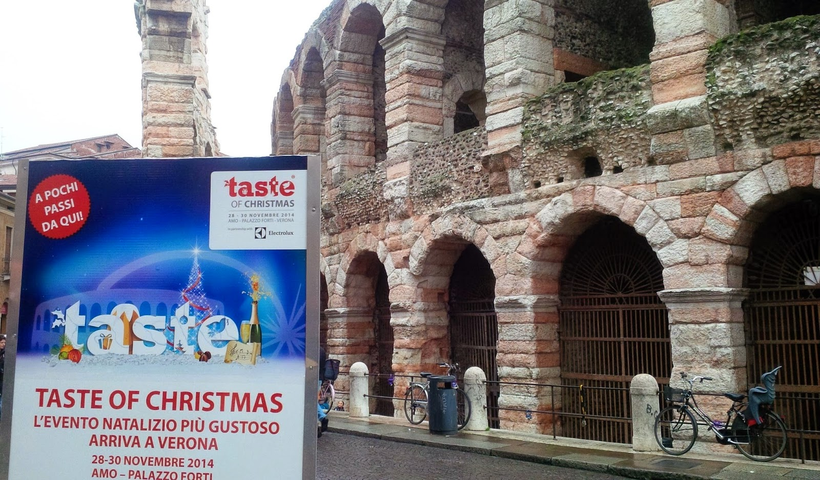 Taste pf Christmas billboard in front of Arena di Verona
