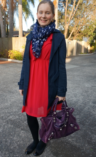 berry pink ruffle detail dress with navy macintosh and bird print scarf, purple Balenciaga work | away from blue