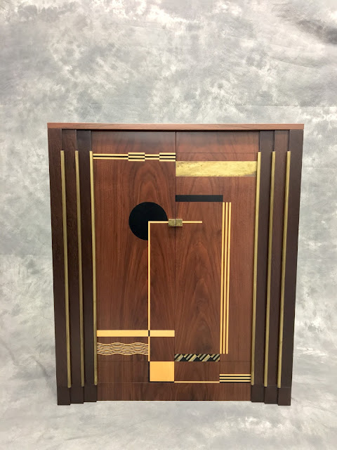 Art deco cubist marquetry cabinet, made from sawn veneer pewter and brass sheet metal.