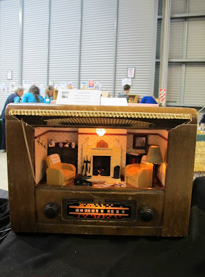 Miniature scene of a 1940s lounge in a vintage radio.