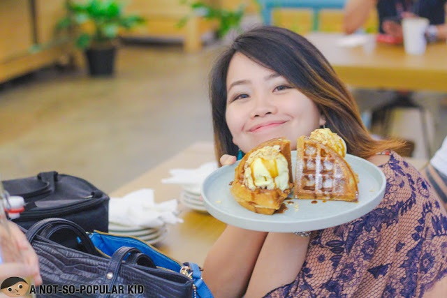 Holding a waffle and ice cream on a place - Yardstick Cafe