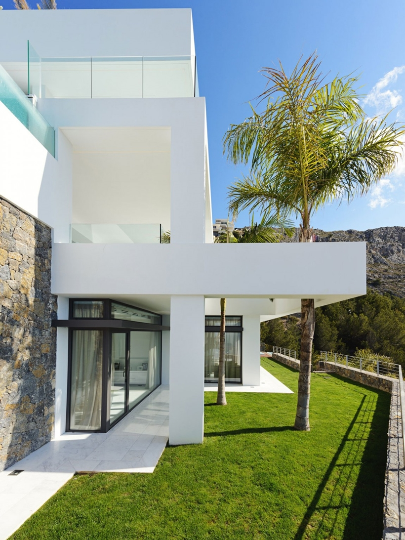 White modern facade and green grass