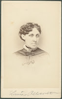 A photograph of Louisa May Alcott.