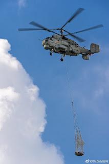 Kamov Ka-28PS con carga a la eslinga